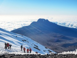 Mount Kilimanjaro - Hikers trudge weary to the summit of the tallest mountain in Africa.