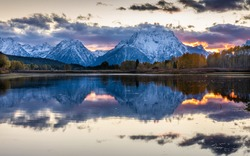 Mount Moran view from Oxbow Bend beside Snake River at sunset of Grand Teton, Wyoming.