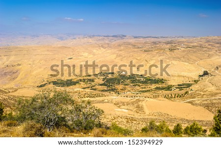 Mount Nebo, an elevated ridge in Jordan, mentioned in the Bible as the place where Moses was granted a view of the Promised Land that he would never enter.
