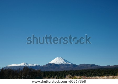 Mount Ngauruhoe, snow capped in the distance. New Zealand's Tongariro National Park, a World Heritage site.
