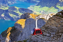 Mount Pilatus aerial cabelway above cliffs and Lake Lucerne landscape, Switzerland