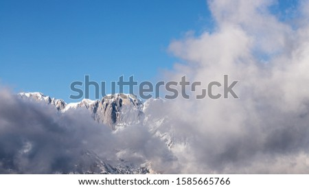 Mount Presolana (Bergamo Dolomites). Snowy peaks and clouds