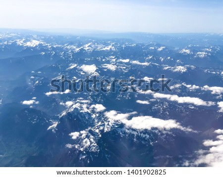 Mount Rainer Mountain Region covered in Snow Aerial View #1401902825