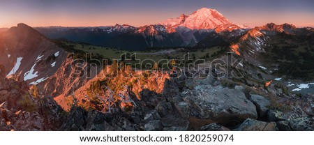 Mount Rainier towers over the surrounding mountains sitting at an elevation of 14,411 ft. It is considered to be one of the world's most dangerous volcanoes. Wonderful Nature landscape. Popular place