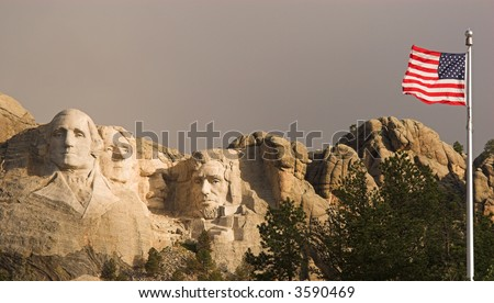 Mount Rushmore and the flag of the United States.