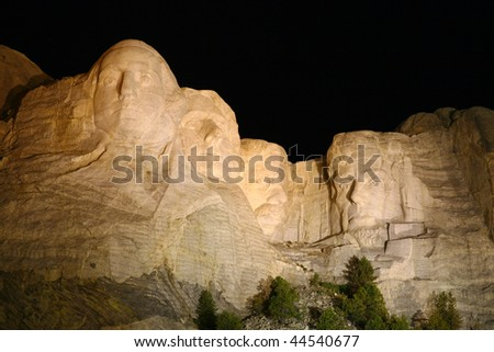 Mount Rushmore Monument Taken at Night While Illuminated with Flood Lights - stock photo