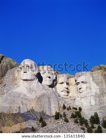 Mount Rushmore National Monument showing the faces of George Washington, Thomas Jefferson, Theodore Roosevelt, and Abraham Lincoln.