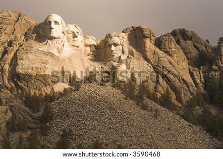 Mount Rushmore with dramatic lighting.