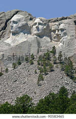 Mount Rushmore with the faces of former presidents George Washington, Thomas Jefferson, Theodore Roosevelt and Abraham Lincoln curved into it