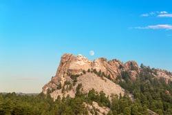 Mount Rushmore with the moon visible near Keystone, South Dakota