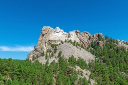 Mount Rushmore with US presidents carved portraits in summer, South Dakota, United States of America, USA.