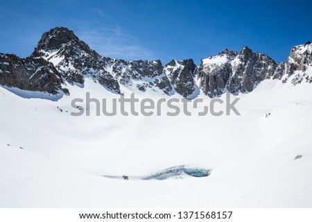 Mount Sill, Polemonium Peak, and the North Palisade make up the skyline of 14,000 ft peaks towering over the Palisade Glacier in California's Eastern Sierra mountains.