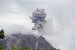 Mount Sinabung spews thick ash and smoke into the sky in Karo, North Sumatra , Indonesia