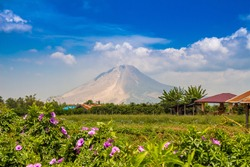 Mount Sinabung volcano on a sunny day in Northern Sumatra, Indonesia.