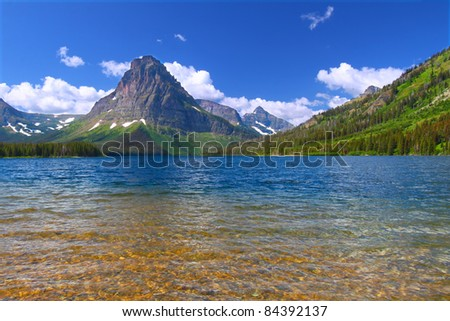 Mount Sinopah rises over Two Medicine Lake on a gorgeous summer day in Glacier National Park