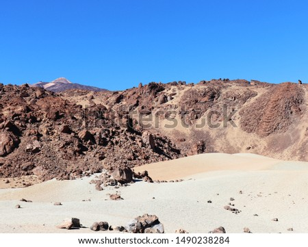 Mount Teide, the third largest volcano in the world, in Teide National Park is  surrounded by lava rocks and sand dunes in Tenerife, Spain on the  Canary Islands.  #1490238284