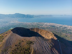 Mount volcano Vesuvius in Napoli. view of the crater of the volcano from above. photo from a drone from the sky