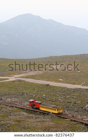 MOUNT WASHINGTON, USA- JULY 8: A passenger train on July 8, 2011 descends Mount Washington, New Hampshire. The Mount Washington Cog Railway started in 1869 and is the world's first such railway.
