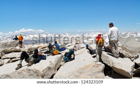 MOUNT WHITNEY, CA - JUNE 30: Hikers rest after a strenuous climb on June 30, 2010, on the summit of Mount Whitney. In 2009 ca. 25,000 people summited the highest peak in the continental United States.
