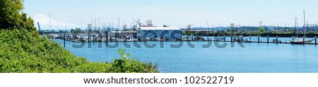 Mountain and port with boats. Puget Sound and Mt. Rainier. Port of Tacoma from Browns Point area( NE Tacoma). Panorama.