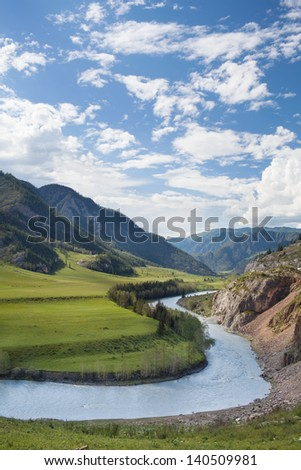 mountain and water with cloudy sky