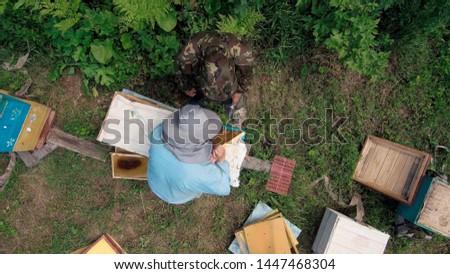 Mountain apiary. Beekeepers at work. Aerial view. Stock fotó ©