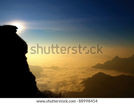 Mountain between clouds in morning with sunrise,Phuchifa, Chiangrai,Thailand