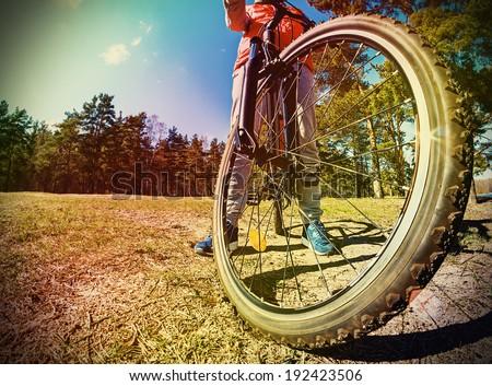 Mountain Bike and blue sky background. photographed on a fisheye lens. Toned image
