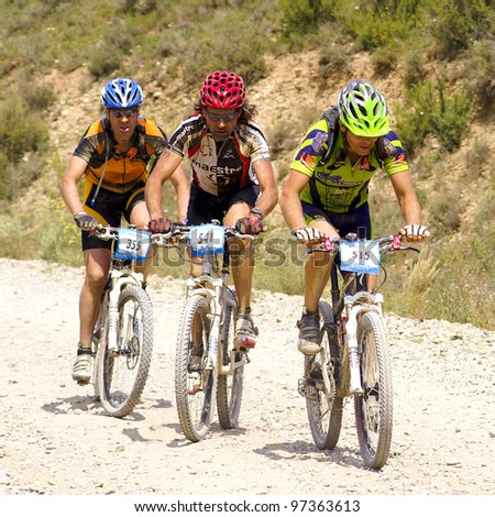 "mountain bike cyclists competing in a race through the nature park dessert ""Las Bardenas"". Temperature reaches 37ºc on June 28th, 2008, in Tudela, Navarre, Spain. BARDENAS REALES, NAVARRE, SPAIN"