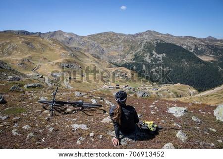 mountain bike girl relaxes on top of  Prokletije Mountains in kosovo Zdjęcia stock ©
