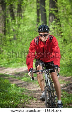 mountain bike race in a forest