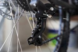 Mountain bike rear derailleur close-up. Rear racing bike cassette on the wheel with chain.