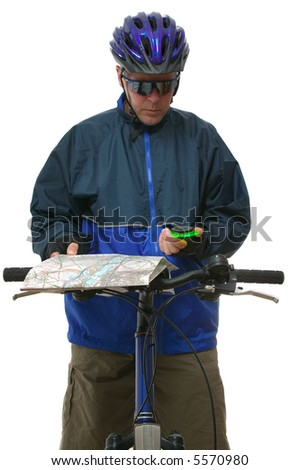 Mountain bike rider reading a map and compass. Isolated on white.
