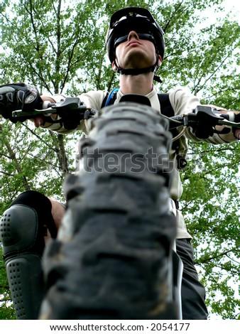 mountain bike tire and the biker boy