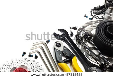 Mountain bike tools and spares on white background - stock photo