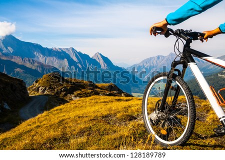 Mountain bike wheel and sommer alpine  landscape #128189789