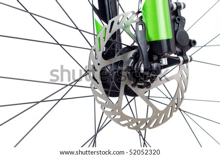 Mountain bike wheel with closeup on hydraulic disc brake isolated on white