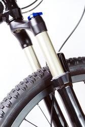 Mountain bike wheel with suspension fork on white background