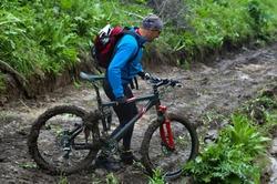 Mountain biker and mud terrain