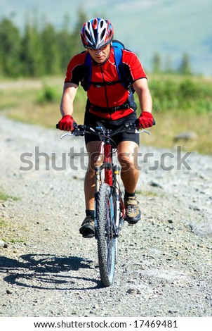Mountain biker on country road