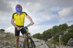 Mountain biker resting near to his bicycle