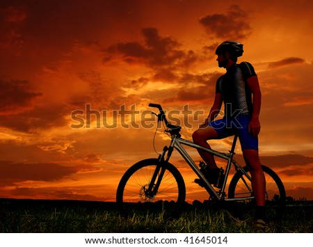 mountain biker silhouette in sunrise