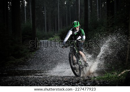 mountain biker speeding through ...