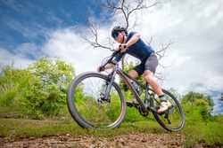 Mountain bikers ride MTB, mountain bike downhill to the extreme. Asian man rides MTB, mountain bike downhill in the wild to extremes. Extreme Sport and MTB, mountain bike downhill Concept.