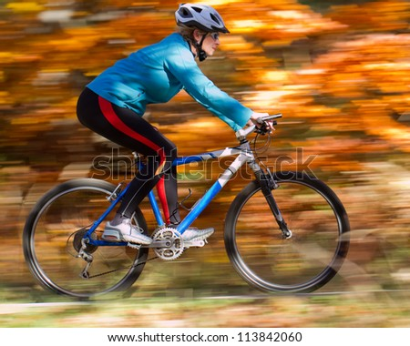 Mountain biking down the trail - stock photo
