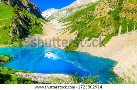 Mountain blue lake water landscape. Blue lake in mountains. Mountain lake view