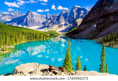 Photo of  Mountain blue lake water landscape. Blue lake in mountains. Mountain lake view. Mountain lake landscape