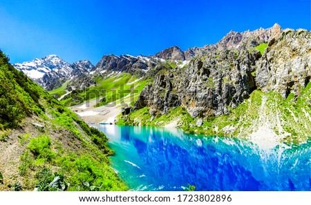 Mountain blue lake water landscape. Lake in mountains. Mountain blue lake