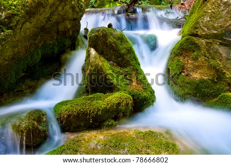Mountain brook with green stones