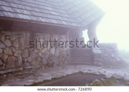 mountain cabin and fog